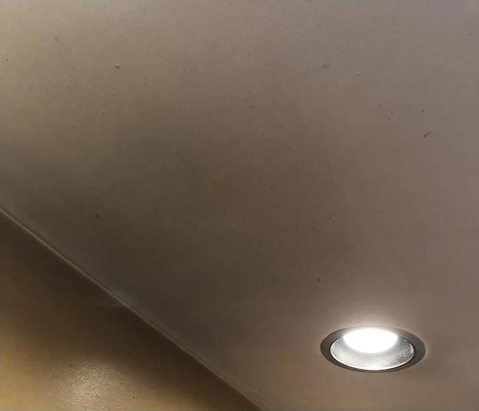 kitchen ceiling with smoke damage on a wall and ceiling