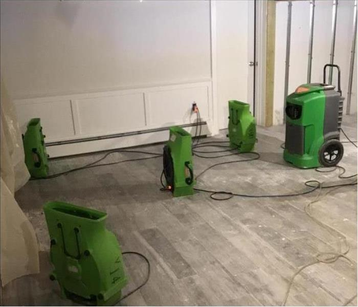 Our air movers working to dry the carpet in this home after water damage